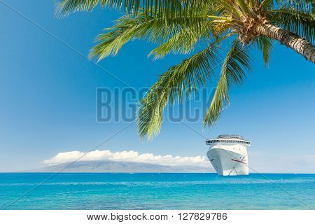 Luxury cruise ship close to tropical beach
