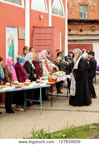 Kursk 30.04.2016- Russian Orthodox Church priest sprinkle holy water Easter cakes and eggs of believers for Easter in the oldest church of Kursk.