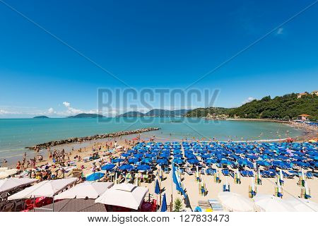 LERICI ITALY - JULY 10 2014: The Venere Azzurra beach crowded with bathers on a sunny day in july. Beach between the villages of Lerici and San Terenzo in the Gulf of La Spezia Liguria Italy