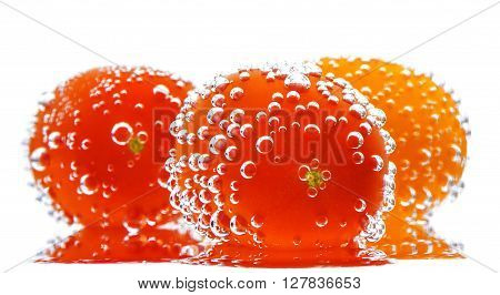 Cherry Tomatoes with gas bubbles. Isolated on a white background.  Soft focus view.