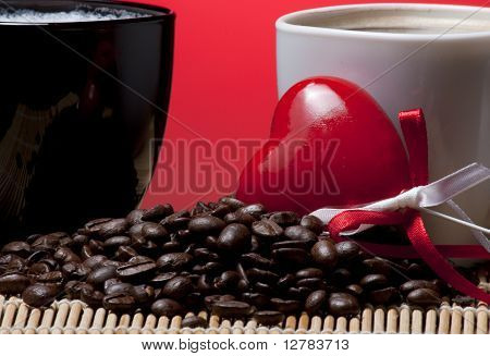 Coffee cups heart and beans
