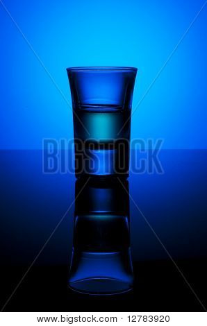 shot glass filled wirh green liquid