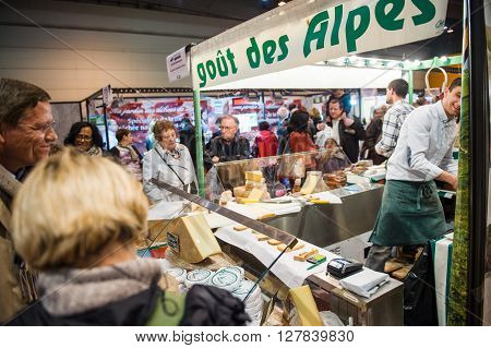 People Buying Cheese And Other French Cheese Products At Market