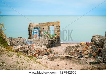 LIEPAJA, LATVIA - AUGUST 2: View on ruined building on Liepaja beach against of endless waterscape Latvia. August 2015