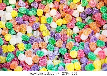 Abstract background of multi-colored candy drops in all flavors