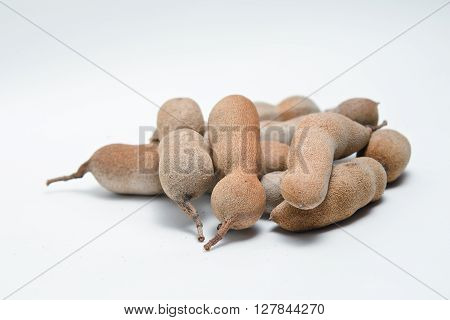 Pile of bitter gourd (Other names are Cucurbitaceae balsam apple balsam pear bitter cucumber bitter melon tamarind) isolated on white background