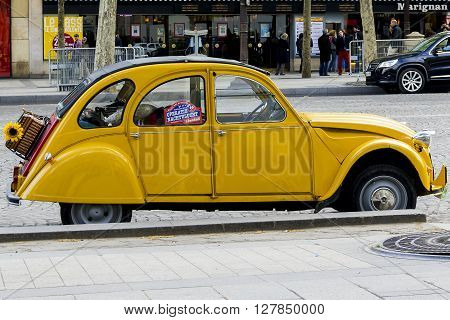 Paris, France - May 12: It is an old yellow Citroen Citroen 2 CB the legend of the French car industry outdoors May 12, 2013 in Paris, France.