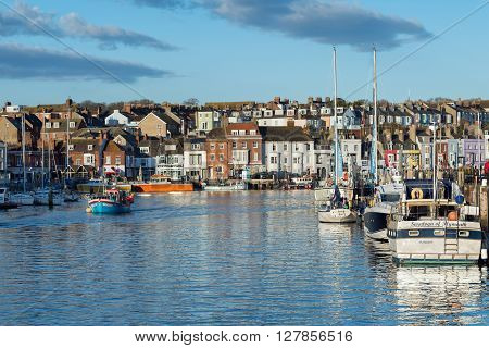 Weymouth, UK - April, 17, 2016. Early morning in Weymouth Harbour Dorset.  Weymouth is a fishing harbour and popular holiday resort.