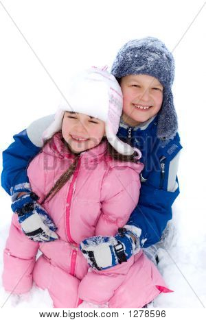 Young Brother And Sister In Snow