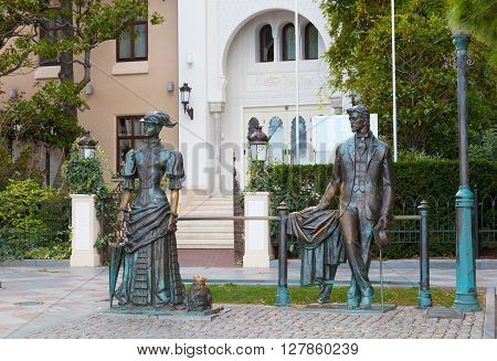 RUSSIA YALTA - SEPTEMBER 24 2015: Sculpture Anton Chekhov and the Lady with Dog in Yalta Crimea