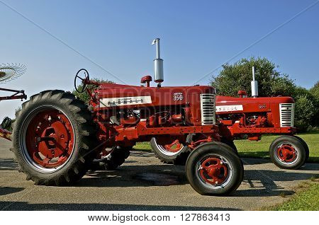 BLACKDUCK, MINNESOTA,, August 13, 2015: A pair of refurbished Farmall 350's were a model name and later a brand name for tractors manufactured by the American company International Harvester. Co. (IH)