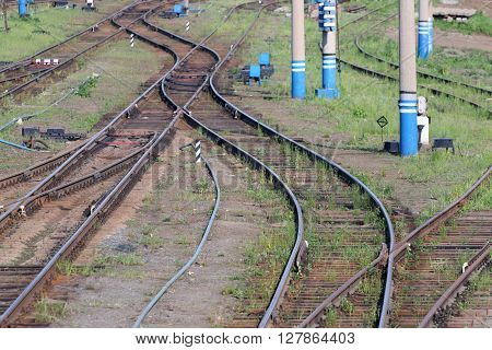 Railways with wooden sleepers poles grass and turnouts at summer