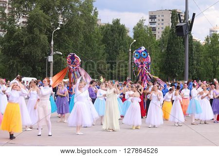 PERM RUSSIA - JUN 12 2015: Dancers in dresses on street show during day of Russia