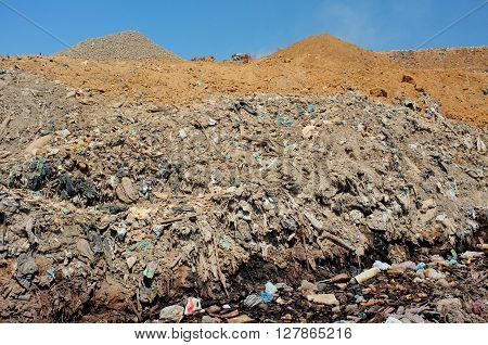 Household waste and industrial garbage contaminates soil and groundwater at Bali's largest landfill site in Suwung Bali Indonesia. The site is vulnerable to leachate infiltration and tidal invasion.