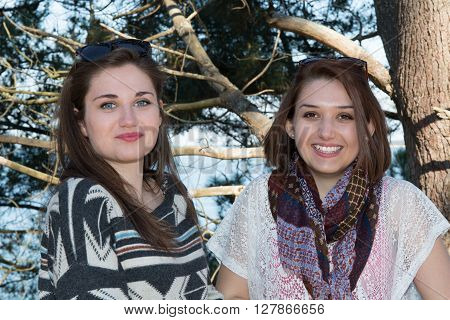 Two Girl On Beach Smiling With Trees