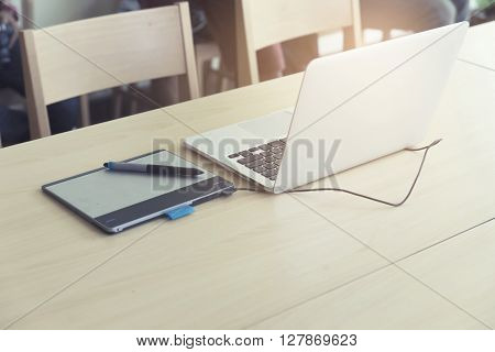 Pen, Digital Graphic Tablet And Computer Notebook On Wooden Table, Vintage Tone