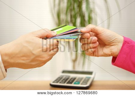 young couple in debts woman choosing credit card for spending