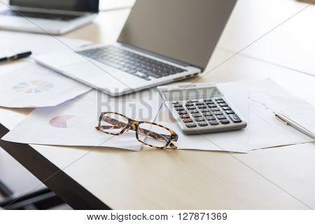 Calculator, Business Document And Computer Notebook