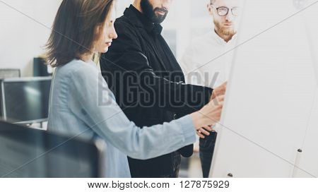 Business meeting photo.Photo man writing statistic info chart board.Photo creative department working with new startup project. Idea presentation, analyze plan, brainstorming. Film effect.