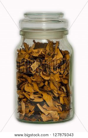 Some dried mushrooms in a glass jar.