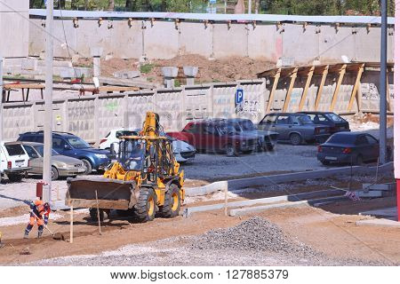 PERM RUSSIA - MAY 15 2015: Tractor on construction site of largest builder of Perm - Factory of silicate panels