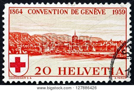 SWITZERLAND - CIRCA 1939: a stamp printed in the Switzerland shows View of Geneva 75th Anniversary of the Founding of the International Red Cross Society circa 1939