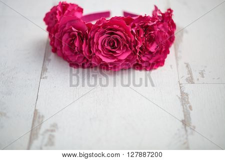 Wraith Of Artificial Red Rose Flowers On Wooden Surface