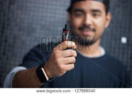 Young Black Man Holding E-cig Vaporizer