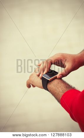Hands Of African Male Using Smart Wrist Watch