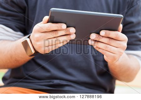 Hands Of Black Guy Using Tablet Pc Weating Smart Watches