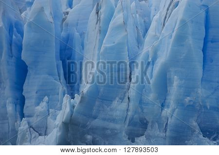 Blue ice cliff of Glacier Grey as it flows into Lago Grey in Torres del Paine National Park, Magallanes, Chile.