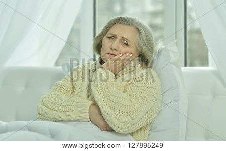 sick senior woman  in bed at home