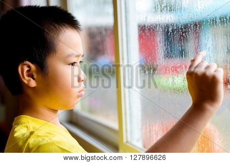 Boy And Glass Window