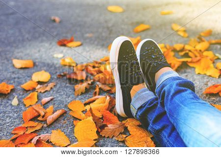 Woman Feet With Jeans And Black Shoes
