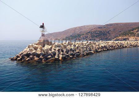 Solid Concrete Dam On Sea Near Island