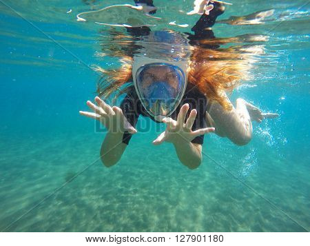 Beautiful woman under water snorkeling in mask, red hair girl snorkeling, woman snorkel in the sea, tropical sea snorkeling, diving in tropical water, sea snorkeling, summer holiday sport activity