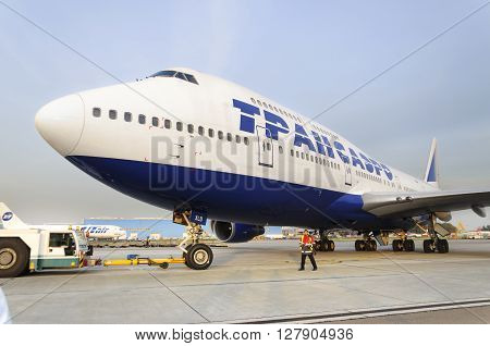 MOSCOW RUSSIA - SEPTEMBER 26 2014: Boeing 747 Transaero towed to the runway. Transaero Airlines has ceased to exist in 2015.