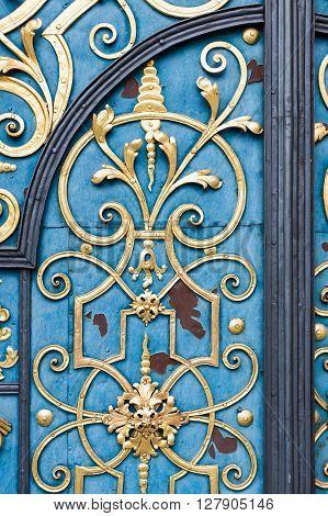 Detail of decorative blue doors with golden details.