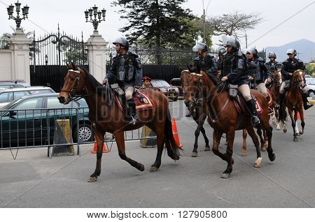 20 November 2010 - Lima, Peru. Peruvian horse police troup near the Government palace on the Plaza de Armas.
