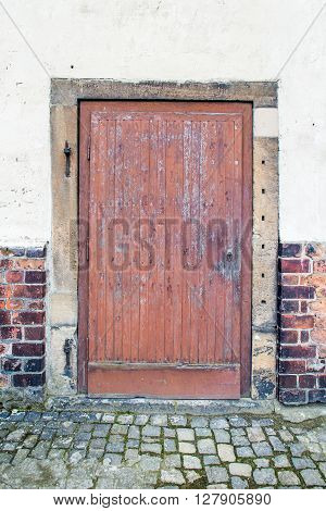 Old wood doors. Red painted without handle.