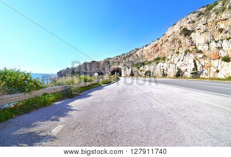 famous tunnel called ''holes of Karamanlis'' were built during his premiership and joins Varkiza with Athens