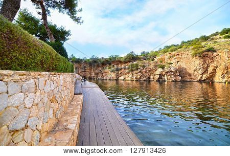 Vouliagmeni lake Greece, known for its constant temperature all the year. Its underwater cave was never fully explored and many divers had been lost in it.