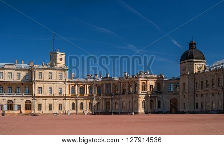 St. Petersburg, Gatchina Palace.  Palace Square and the main entrance. Central building with balconies, lateral tower, lights and water moat.