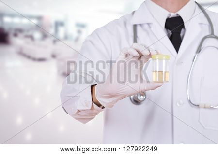 Doctor's Hand Holding A Bottle Of Urine Sample In Hospital