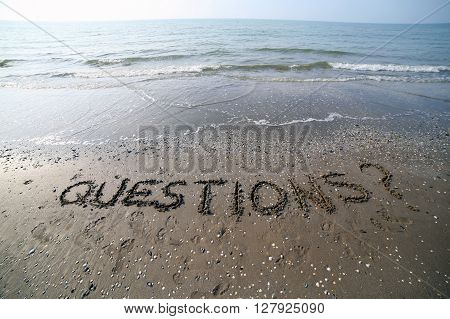 Word Questions Written In Large Letters On The Sand