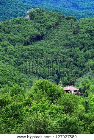 Village house and rock in Balkan mountains