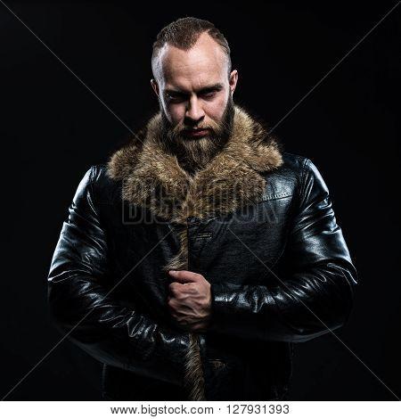 Brutal Handsome Glum Unshaven Man With Beard