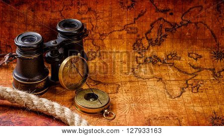 Old Vintage Retro Compass And Spyglass On Ancient World Map