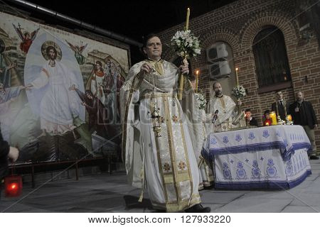 Bucharest Romania April 30 2016: Romanian Orthodox priests conduct a holy liturgy during an Orthodox Easter service outdoor near Sfantul Anton church.