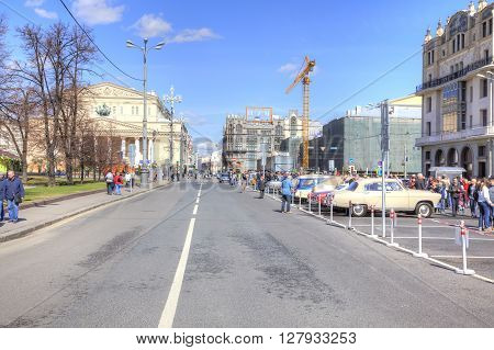 MOSCOW RUSSIA - April 24.2016: City landscape. Theatre Square vintage car exhibition Bolshoi Theatre and Petrovka Street